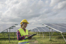 Engineer-electric-woman-checking-and-maintenance-of-solar-cells